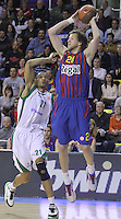 20.03.2012 Barcelona, Spain. Euroleague Playoff game 1. Picture show Joe Ingles (R) and Kelly McCarty(L) in action during match between FC Barcelona Regal against Unics Kazan at Palau Blaugrana