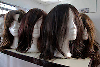 Wigs for cancer patients are displayed in a room before being donated as a commitment to actively fight against cancer in Medellin, Colombia, May 25, 2012.  Colombia celebrated on 31 January, 7, 14 and 21 February some days of donating hair in Beauty Centres Fundayama ALQVIMIA and foundation (Foundation for support and support people with breast cancer), it received 300 donations of hair with which they made 200 wigs  Photo by Fredy Amariles/View