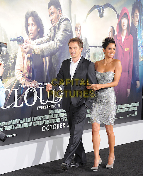 Olivier Martinez & Halle Berry.The L.A. Premiere of 'Cloud Atlas' held at The Grauman's Chinese Theatre in Hollywood, California, USA..October 24th, 2012 .full length dress silver strapless lace grey gray shoes black suit white shirt couple arms linked .CAP/RKE/DVS.©DVS/RockinExposures/Capital Pictures.