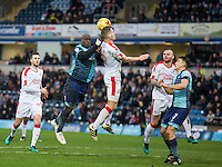 Adebayo Akinfenwa of Wycombe Wanderers & James Collins of Crawley Town go up for the ball during the Sky Bet League 2 match between Wycombe Wanderers and Crawley Town at Adams Park, High Wycombe, England on 25 February 2017. Photo by Andy Rowland / PRiME Media Images.
