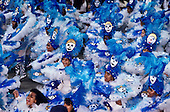 Rio de Janeiro, Brazil. Samba school; blue and white feather costumes with clown faces; Carnival.