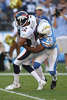 11/27/11 San Diego, CA: Denver Broncos wide receiver Matt Willis #12 and San Diego Chargers cornerback Quentin Jammer #23 during an NFL game played between the Denver Broncos and the San Diego Chargers at Qualcomm Stadium. The Broncos defeated the Chargers 16-13 in OT