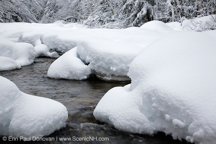 Swift River covered in snow during the winter months in the White Mountains of New Hampshire. This river runs along the side of the Kancamagus Highway (route 112).