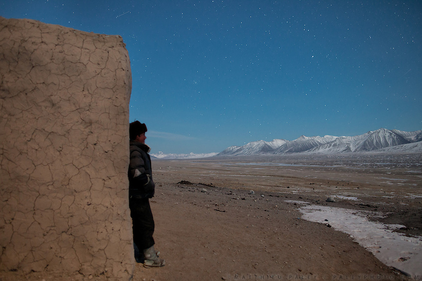 The orphan Juma Boi under the stars. The Kyrgyz settlement of Ech Keli, above Chaqmaqtin lake, Er Ali Boi's camp...Trekking through the high altitude plateau of the Little Pamir mountains, where the Afghan Kyrgyz community live all year, on the borders of China, Tajikistan and Pakistan.