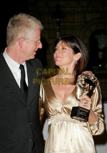 RICHARD CURTIS & EMMA FREUD .The British Academy Television Awards (BAFTA) afterparty at the Natural History Museum, London, England. .May 20th, 2007.half length black suit jacket beige satin gold profile glasses trophy award.CAP/AH.©Adam Houghton/Capital Pictures