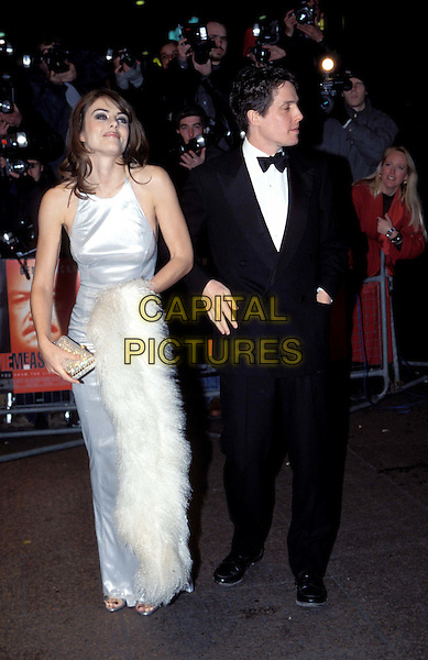 LIZ HURLEY & HUGH GRANT.ELIZABETH HURLEY.long white halterneck dress, ex celebrity couple.Ref:4530/2901g.www.capitalpictures.com.sales@capitalpictures.com.© Capital Pictures