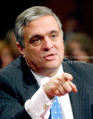 Washington, D.C. - March 24, 2004 -- United States Director of Central Intelligence George J. Tenet testifies before The National Commission on Terrorist Attacks Upon the United States (also known as the 9-11 Commission) in Washington, D.C. on March 24, 2004.<br /> Credit: Ron Sachs / CNP<br /> [RESTRICTION: No New York Metro or other Newspapers within a 75 mile radius of New York City]