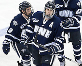 Matt Willows (UNH - 9) and Trevor van Riemsdyk (UNH - 6) celebrate van Riemsdyk's goal which made it 6-2 BC early in the third period. - The Boston College Eagles defeated the visiting University of New Hampshire Wildcats 6-2 on Friday, December 6, 2013, at Kelley Rink in Conte Forum in Chestnut Hill, Massachusetts.