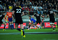 France's Teddy Thomas tries to find a way through the All Blacks defence during the Steinlager Series international rugby match between the New Zealand All Blacks and France at Westpac Stadium in Wellington, New Zealand on Saturday, 16 June 2018. Photo: Dave Lintott / lintottphoto.co.nz