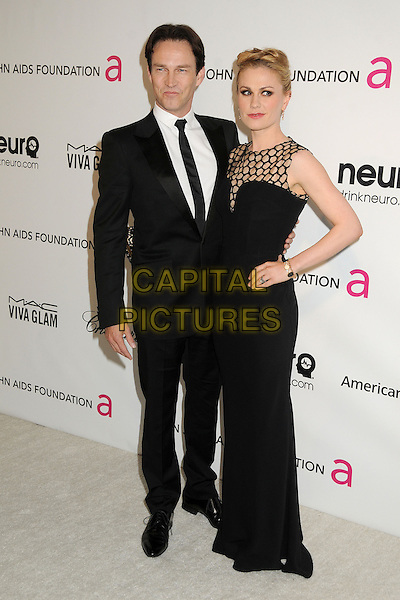 Stephen Moyer, Anna Paquin.21st Annual Elton John Academy Awards Viewing Party held at West Hollywood Park, West Hollywood, California, USA..February 24th, 2013.oscars full length black suit sleeveless dress hand on hip netting married husband wife .CAP/ADM/BP.©Byron Purvis/AdMedia/Capital Pictures.
