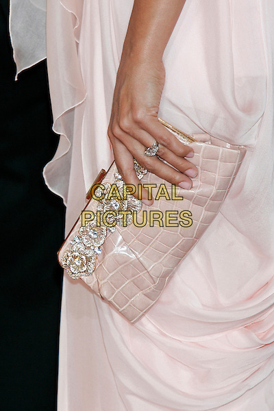 LUCIANA BARROSO's bag.82nd Annual Academy Awards - Oscars.Kodak Theatre, Hollywood, California, USA.7th March 2010.arrivals pink silver clutch hand flowers.CAP/JE  .©James Eden/Capital Pictures.