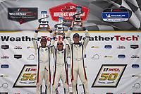 GS Podium winners, #46 Team TGM Mercedes-AMG, GS: Owen Trinkler, Hugh Plumb, with team owner Ted Geovonis