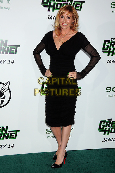 """KARI BYRON .Attending Columbia Pictures' premiere of """"The Green Hornet"""" Los Angeles Premiere held at Grauman's Chinese Theatre, Hollywood, California, USA, 10th January 2011..full length long sleeve dress hands on hips  black  gold wishbone necklace .CAP/ADM/BP.©Byron Purvis/AdMedia/Capital Pictures."""