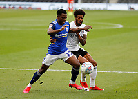 4th July 2020; Craven Cottage, London, England; English Championship Football, Fulham versus Birmingham City; Cyrus Christie of Fulham challenges Jeremie Bela of Birmingham City