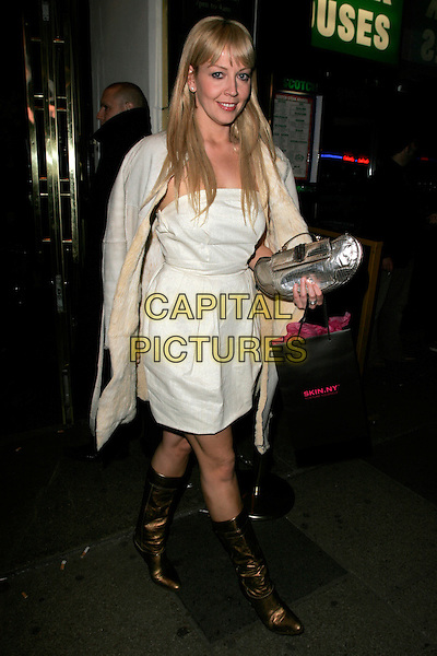 LIZ FULLER.Duncan James' Birthday Party, Pigalle Club, Picadilly, London, England..April 8th, 2008.full length white strapless dress fur lined coat jacket gold bronze boots silver bag purse goody bag .CAP/AH.©Adam Houghton/Capital Pictures.