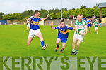 Listry V St Senan's : Listry's  John Foley gets the ball away depite the close attention of St Senan's Paudie Somer & Alan Kennelly.