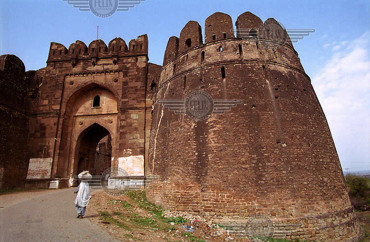 Gateway of the Rohtas Fort near Dina in Pakistan. This enormous fortification, its outer wall are three miles in circumference, was built by Sher Shah Suri as his main base to protect the Grand Trunk Road in the central Punjab. Sher Shah Suri was a sixteenth century Afghan ruler of northern India famous for laying out the route of the Grand Trunk Road that is still in use today.