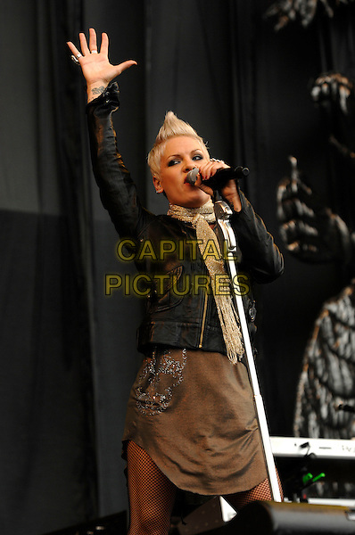 PINK.Performs live  at the V Festival 2007, Hylands Park,.Chelmsford, Essex, England, August 18th 2007..half length pinnk on stage gig concert black leather jacket   microphone hand gold scarf hand arm up.CAP/PL.©Phil Loftus/Capital Pictures