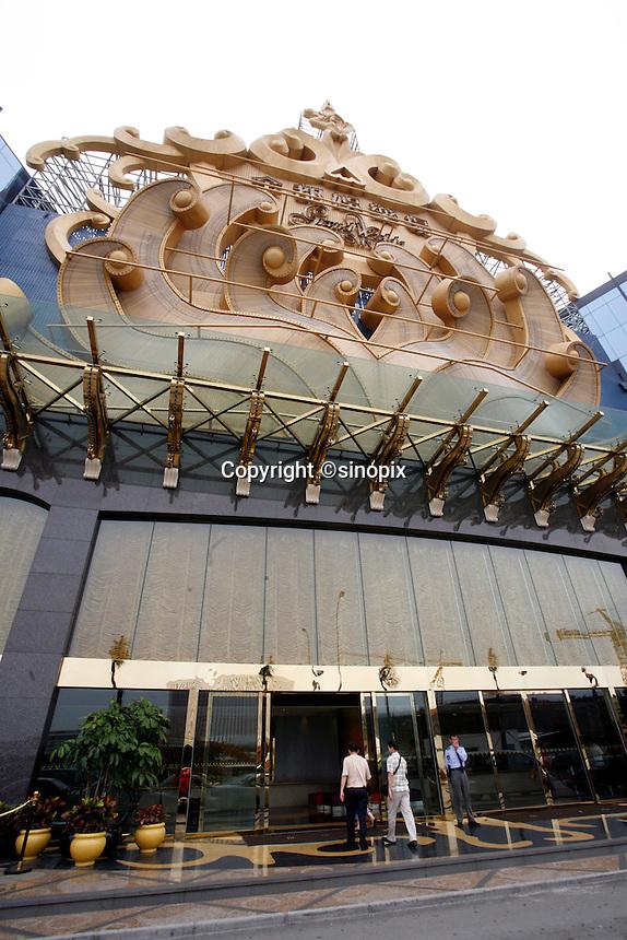 Tourists walk into the newly opened Grand Waldo Casino in Macau.<br /> May 08, 2007