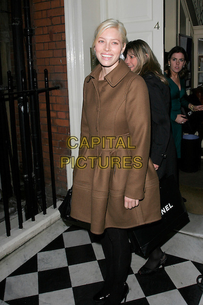 JESSICA BIEL.Finch and Partners Pre-Bafta Party held at Mark's Club, Mayfair, London, England. .February 9th 2008 .full length black tights brown coat hand in pocket .CAP/AH.©Adam Houghton/Capital Pictures.