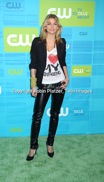 """AnnaLynne McCord of """"90210"""" posing for photographers at the CW Network 2010 Upfront on May 20, 2010 at Madison Square Garden in New York City."""
