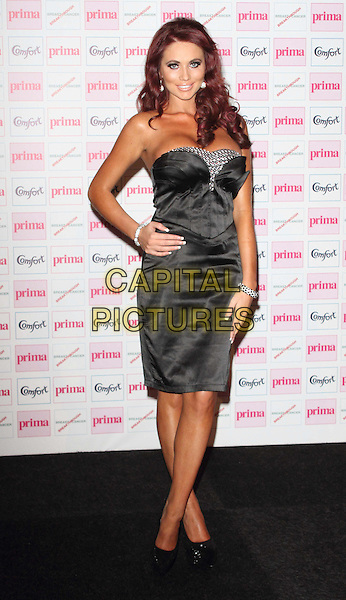 Amy Childs.Comfort Prima High Street Fashion Awards held at the Battersea Evolution, Battersea, London, England..September 13th 2012.full length black strapless dress silver hand on hip .CAP/ROS.©Steve Ross/Capital Pictures