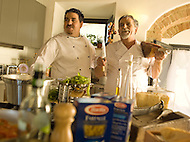 A Father-Son Chef team enjoy eachother's company while making pasta with Proscuitto in a beautiful Italian kitchen.