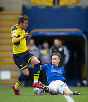 Tom Hamer of Oldham Athletic tackles Joe Rothwell of Oxford United during the Sky Bet League 1 match between Oxford United and Oldham Athletic at the Kassam Stadium, Oxford, England on 7 April 2018. Photo by Andy Rowland.