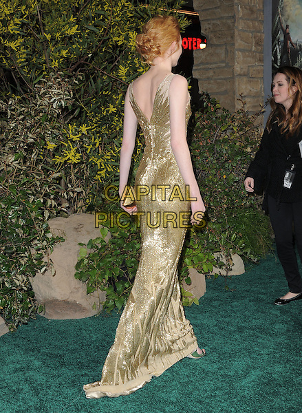 "Eleanor Tomlinson.""Jack The Giant Slayer"" Los Angeles Premiere held at Grauman's Chinese Theatre, Hollywood, California, USA..February 26th, 2013.full length gold dress metallic beads beaded back behind rear  clutch bag.CAP/RKE/DVS.©DVS/RockinExposures/Capital Pictures."