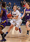 SIOUX FALLS, SD - MARCH 10:  Amanda Hyde #11 of IPFW drives between Western Illinois defenders Charnelle Reed #4 and Michelle Maher #14 during their game at 2013 Summit League Basketball Championships Sunday at the Sioux Falls Arena. (Photo by Dick Carlson/Inertia)