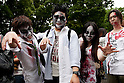 Attendees dressed as zombies stroll through Yoyogi Park on May 16, 2015, Tokyo, Japan. The annual Yoyogi Park Zombie Walk involves people of all ages dressing up as zombies and turning into the walking dead. The event website instructs participants about zombies manners such as not chasing spectators and no littering. (Photo by Rodrigo Reyes Marin/AFLO)