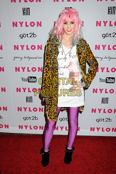 AUDREY KITCHING.Nylon Magazine's Young Hollywood Party held at the Roosevelt Hotel's Tropicana Bar, Hollywood, California, USA..May 12th, 2010.full length pink green dyed hair hand on hip band head headband hairband purple tights brown black white top leopard print coat jacket.CAP/ADM/BP.©Byron Purvis/AdMedia/Capital Pictures.