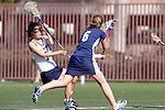 Santa Barbara, CA 02/13/10 - Brooke Smith (BYU # 6) and Rachel Lee (UC Davis # 1) in action during the BYU-UC Davis game at the 2010 Santa Barbara Shoutout, UC Davis defeated BYU 9-7.
