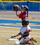 WATERBURY,  CT-071918JS04--Diamond Elite's Nick Mitchell (19) slides safely into second base as Wolcott's Wolcott's Lucas Cornelio  (11) waits for the throw during their Roberto Clemente tournament game Thursday at Municipal Stadium in Waterbury. <br /> Jim Shannon Republican American