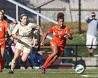 University of Miami midfielder Jordan Roseboro (6) dribbles as Boston College defender McKenzie Meehan (22) closes..After two overtime periods, Boston College (gold) tied University of Miami (orange), 0-0, at Newton Campus Field, October 21, 2012.