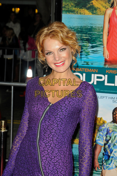 "JANNA FASSAERT.The American premiere of ""Couples Retreat"" at Mann Village Theatre in Westwood, California, USA..October 5th, 2009  .half length purple dress zip zipper long sleeves pattern lace.CAP/ROT.©Lee Roth/Capital Pictures"