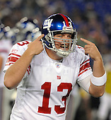Baltimore, MD - August 19, 2007 -- New York Giants quarterback Jared Lorenzen (13) complains to the bench that he cannot hear the signals in his helmet in first half action against the Baltimore Ravens at M&T Bank Stadium in Baltimore, Maryland on Sunday, August 19, 2007.  At the half the score is Giants 7 - Ravens 6.<br />