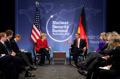 United States President Barack Obama speaks to Angela Merkel, Germany's chancellor, left, during a bilateral meeting at the Nuclear Security Summit in Washington, D.C., U.S., on Tuesday, April 13, 2010.  Obama urged world leaders today to confront the prospect of nuclear terrorism and take concrete action to head off what he called one of the greatest threats to global security. .Credit: Andrew Harrer / Pool via CNP