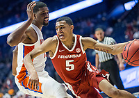 NWA Democrat-Gazette/BEN GOFF @NWABENGOFF<br /> Jalen Harris, Arkansas guard, drives on Kevarrius Hayes, Florida center, in the first half Thursday, March 14, 2019, during the second round game in the SEC Tournament at Bridgestone Arena in Nashville.