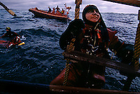 Climbing Rope Ladder..Nonetheless, safety is paramount--everyone who works on the platform goes through a strenuous safety course...they take 50-year-old accountants and throw them into the ocean and watch them puke in covered life rafts.  I'm happy to say that the instructor and I were the only ones not to get seasick on the trip out of the harbor into 16 foot seas...