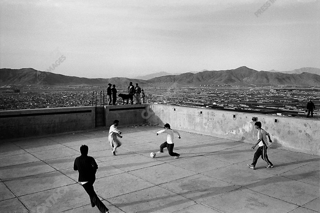 Soccer game inside an abandoned swimming pool on a hilltop in central Kabul, Afghanistan, 2007