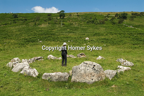 Yockenthwaite Stone Circle, hamlet of Craven North Yorkshire. Langstrothdale valley in the Yorkshire Dales National Park. Warfedale. Woman feeling the energy.