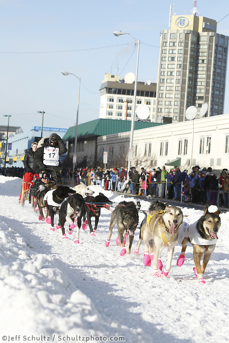 Lance Mackey and team run down 4th avenue in downtown Anchorage, Alaska during the ceremonial start of the 2011 Iditarod
