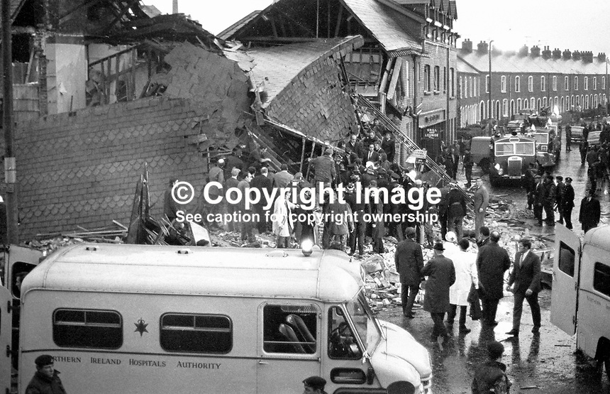 Ambulance, fire engines and police landrovers at the scene of the explosion at the Red Lion pub on the Ormeau Road, Belfast, N Ireland, on 2nd November 1971. Three men died in the Provisional IRA bombing. The bar was beside Ballynafeigh RUC station. 197111020430b.<br />