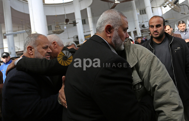 Chairman of the political bureau of the Hamas Palestinian Islamist movement, Ismail Haniyeh attends the funeral of Palestinian Amal el-Tramsi, 43, who was shot dead by Israeli troops during clashes on Israel-Gaza border, in Gaza city, on January 12, 2019. Photo by Ashraf Amra
