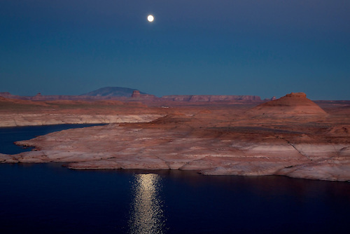 A full moon rises over Lake Powell at The Glen Canyon National Recreation Area at Page, Arizona