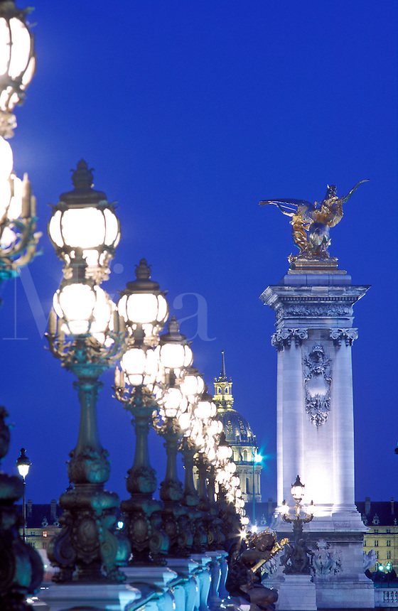 France, Paris, Pont Alexandre III with ornate lamps illuminated