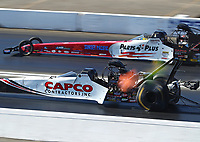Nov 16, 2019; Pomona, CA, USA; NHRA top fuel driver Steve Torrence (near) alongside Clay Millican during qualifying for the Auto Club Finals at Auto Club Raceway at Pomona. Mandatory Credit: Mark J. Rebilas-USA TODAY Sports