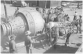 An eight-foot Hardinge ball mill on skid being pulled by horses after it was unloaded from a box car in the Rico yards.<br /> RGS  Rico, CO  ca. 1938
