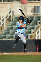 Frainyer Chavez (11) of the Hickory Crawdads at bat against the Kannapolis Intimidators at Kannapolis Intimidators Stadium on May 6, 2019 in Kannapolis, North Carolina. The Crawdads defeated the Intimidators 2-1 in game one of a double-header. (Brian Westerholt/Four Seam Images)